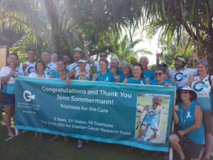 Jen group shot with banner in Hawaii